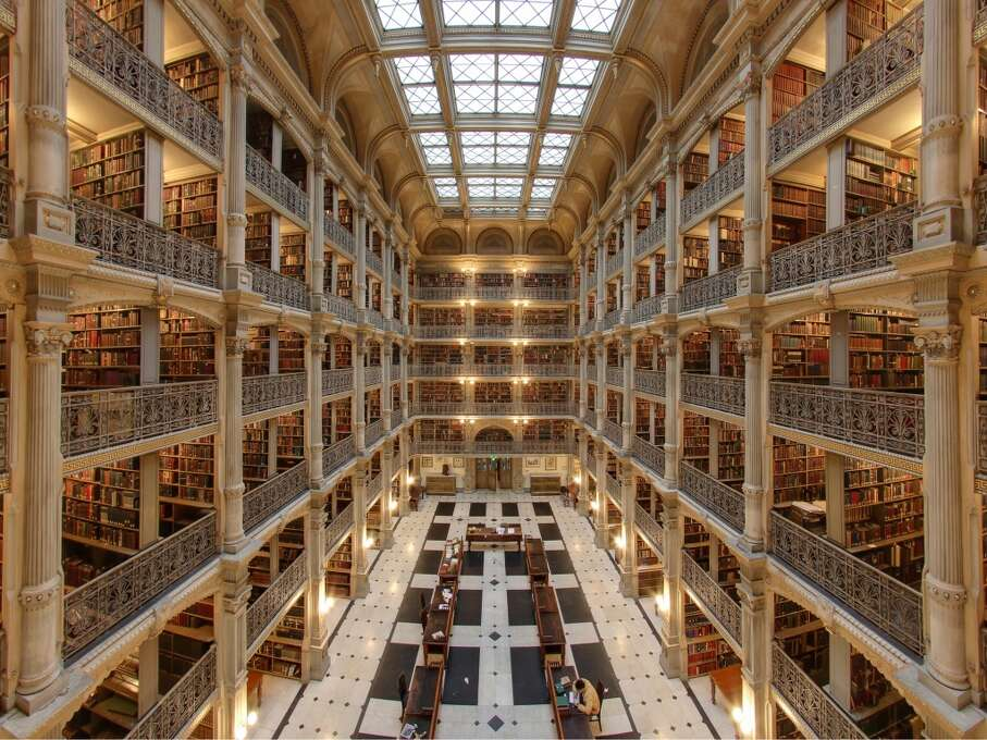 Opened in 1878, Baltimore's George Peabody Library uses iron throughout to create a lofty space topped by a vaulted ceiling. Photo: Matthew Petroff