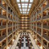 Opened in 1878, Baltimore's George Peabody Library uses iron throughout to create a lofty space topped by a vaulted ceiling.