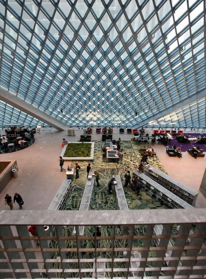 "The Seattle Public Library's Central Library opened in 2004. Writing in The New Yorker, critic Paul Goldberger called it ""the most important new library to be built in a generation, and the most exhilarating."" Photo: Gabriel Bouys, AFP/Getty Images"