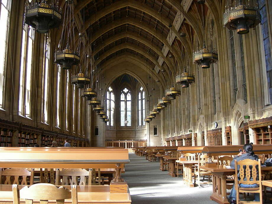 "The Suzzallo Library at the University of Washington in Seattle is graced with a cathedral ceiling and stained glass windows. Henry Suzzallo, the university's former president, likened universities to ""cathedrals of learning."" Photo: Joe Mabel"
