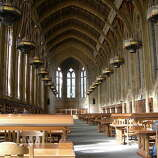 "The Suzzallo Library at the University of Washington in Seattle is graced with a cathedral ceiling and stained glass windows. Henry Suzzallo, the university's former president, likened universities to ""cathedrals of learning."""