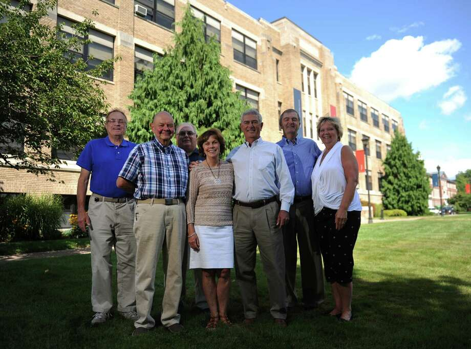 Danbury High School class of 1964 members, from left, Michael Stein, of Danbury, Alan Mattei, of Southbury, Ted Lucas, of Danbury, Shirley and Terry Rodrigues, of Brookfield, Vin Iovino, of Southbury, and Phyllis Scarpone, of New Milford, pose outside of Western Connecticut State University's White Hall in Danbury, Conn. Monday, Aug. 18, 2014. White Hall used to be Danbury High School and the class of 1964 was the final graduating class from there. Photo: Tyler Sizemore / The News-Times