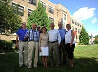 Danbury High School class of 1964 members, from left, Michael Stein, of Danbury, Alan Mattei, of Southbury, Ted Lucas, of Danbury, Shirley and Terry Rodrigues, of Brookfield, Vin Iovino, of Southbury, and Phyllis Scarpone, of New Milford, pose outside of Western Connecticut State University's White Hall in Danbury, Conn. Monday, Aug. 18, 2014. White Hall used to be Danbury High School and the class of 1964 was the final graduating class from there.