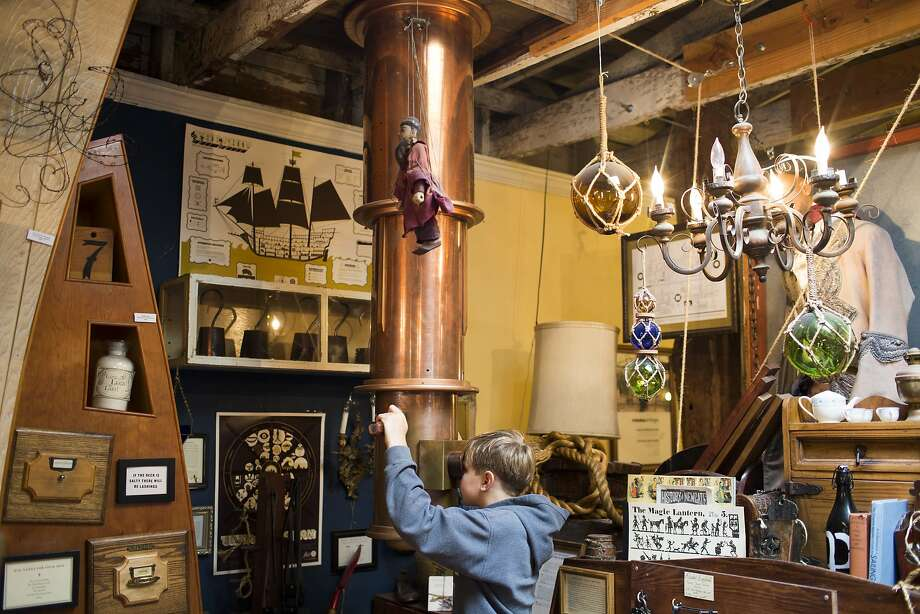 Nick Gaensler, 11, of San Francisco looks into a periscope at 826 Valencia's pirate supply store. Photo: Tim Hussin, Special To The Chronicle