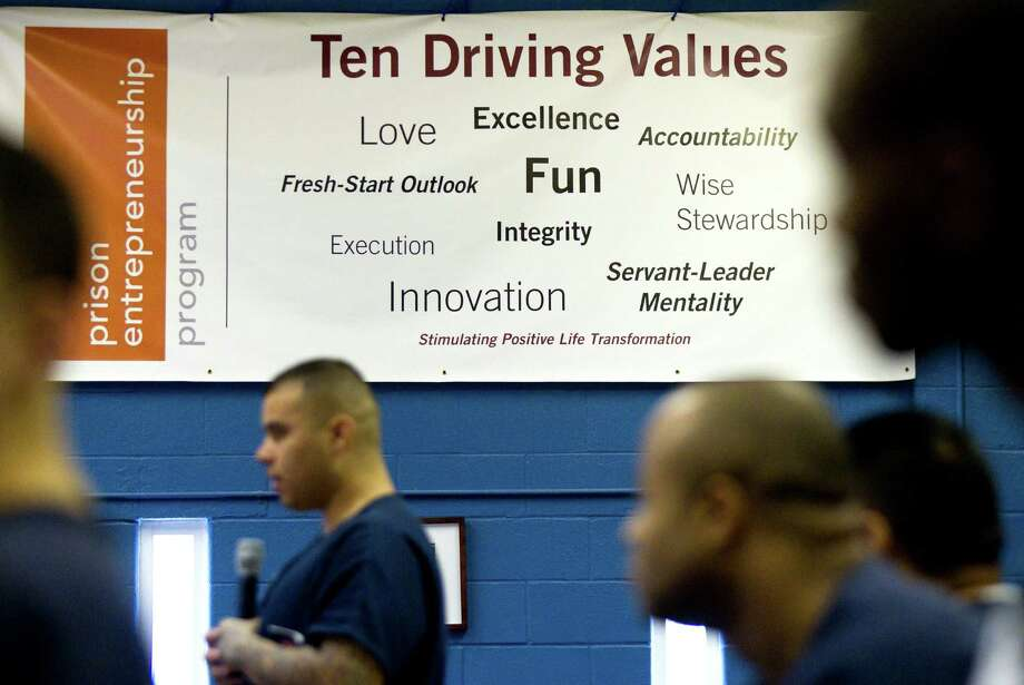 The Ten Driving Values of the Prison Entrepreneurship Program hangs on the wall at the Cleveland Correctional Center on Thursday, Feb. 14, 2013, in Cleveland, Texas. PEP is a privately-run program that trains inmates how to run their own businesses once they are paroled.  ( Brett Coomer / Houston Chronicle ) Photo: Brett Coomer, Staff / © 2013 Houston Chronicle