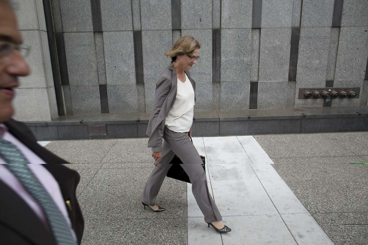 San Bruno City Manager Connie Jackson walks away with senior adviser Craig Bettencourt, left, after addressing media about the PG&E case regarding an array of felony charges connected with a fatal natural gas explosion in San Bruno at the federal courthouse in San Francisco, Calif. on Monday, August 18, 2014. PG&E pleaded not guilty.