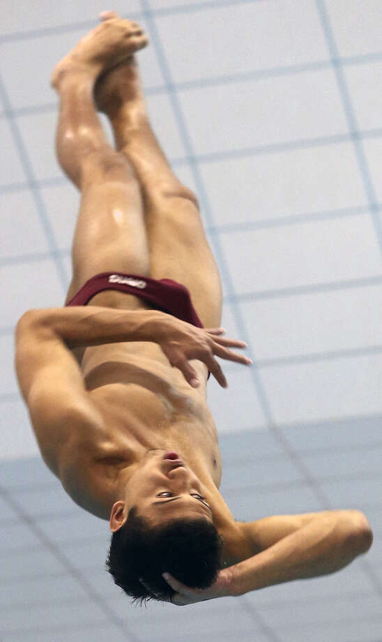 Marshall's Christopher Law spins through the diving competition at the 5A state swimming and diving champion-ships at the Jamail Center in Austin in February. Photo: Tom Reel / San Antonio Express-News