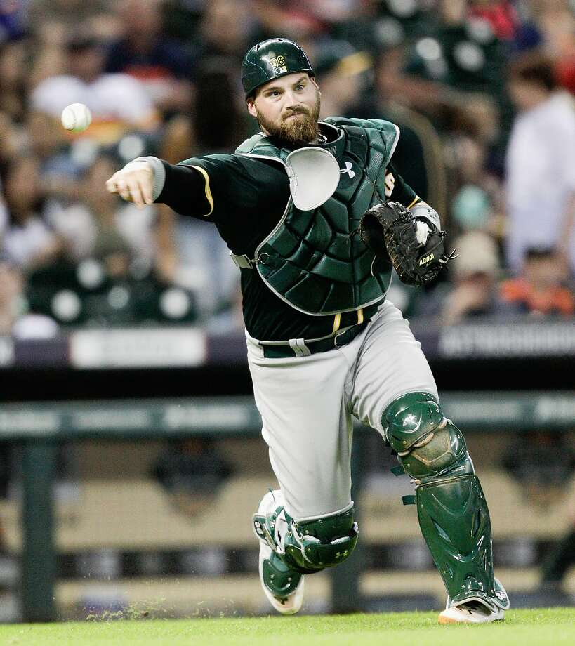 HOUSTON, TX - JULY 29:  Derek Norris #36 of the Oakland Athletics throws to first base to retire Marc Krauss #18 of the Houston Astros in the sixth inning at Minute Maid Park on July 29, 2014 in Houston, Texas.  (Photo by Bob Levey/Getty Images) Photo: Bob Levey, Getty Images