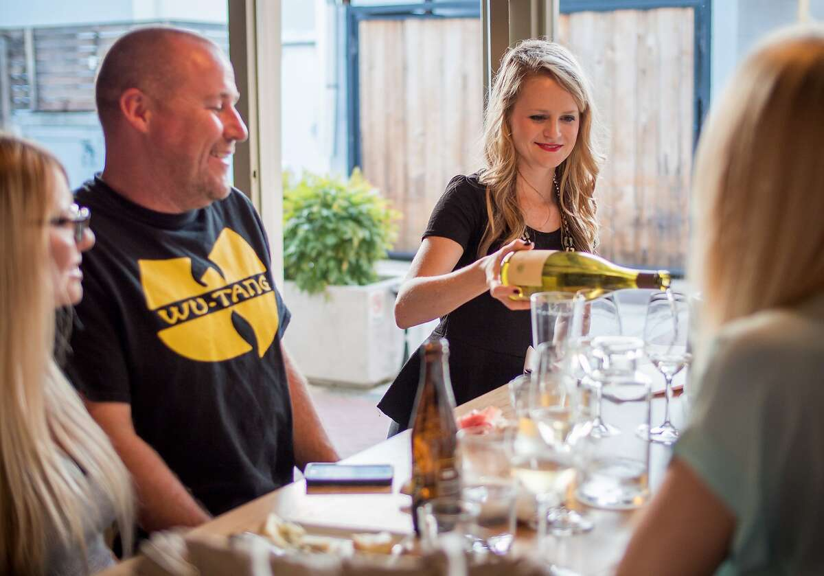 Colleen Fleming serves wine to a couple at Cadet wine bar in Napa, Calif., on Saturday, August 9th, 2014.