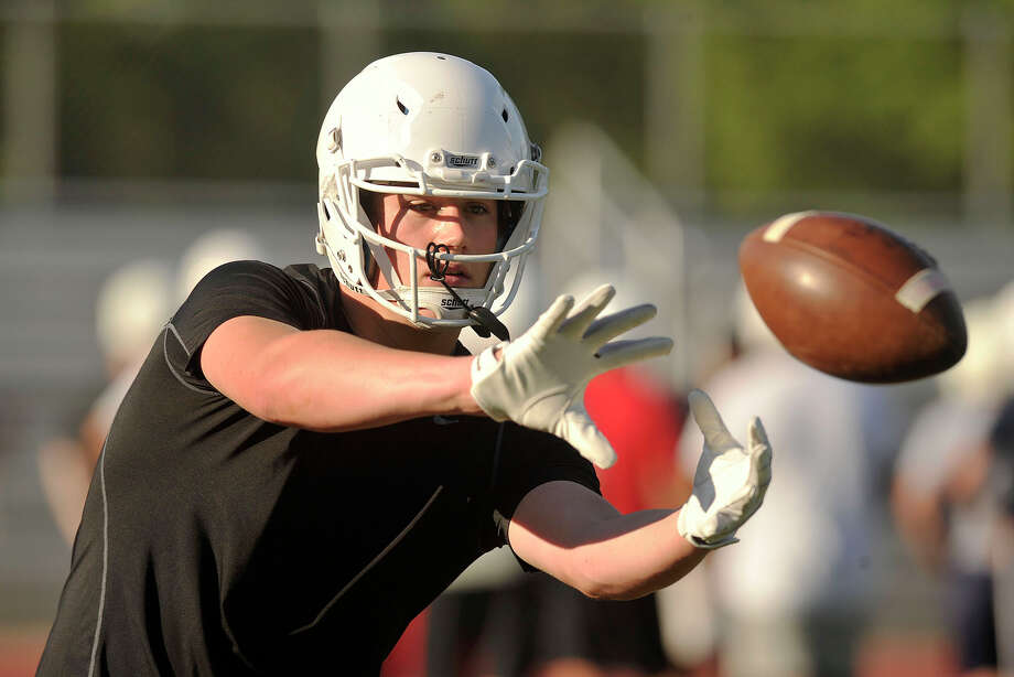 Tight end Scott (Scooter) Harrington runs drills during football practice at Greenwich High School in Greenwich, Conn., on Monday, Aug. 18, 2014. Photo: Jason Rearick / Stamford Advocate