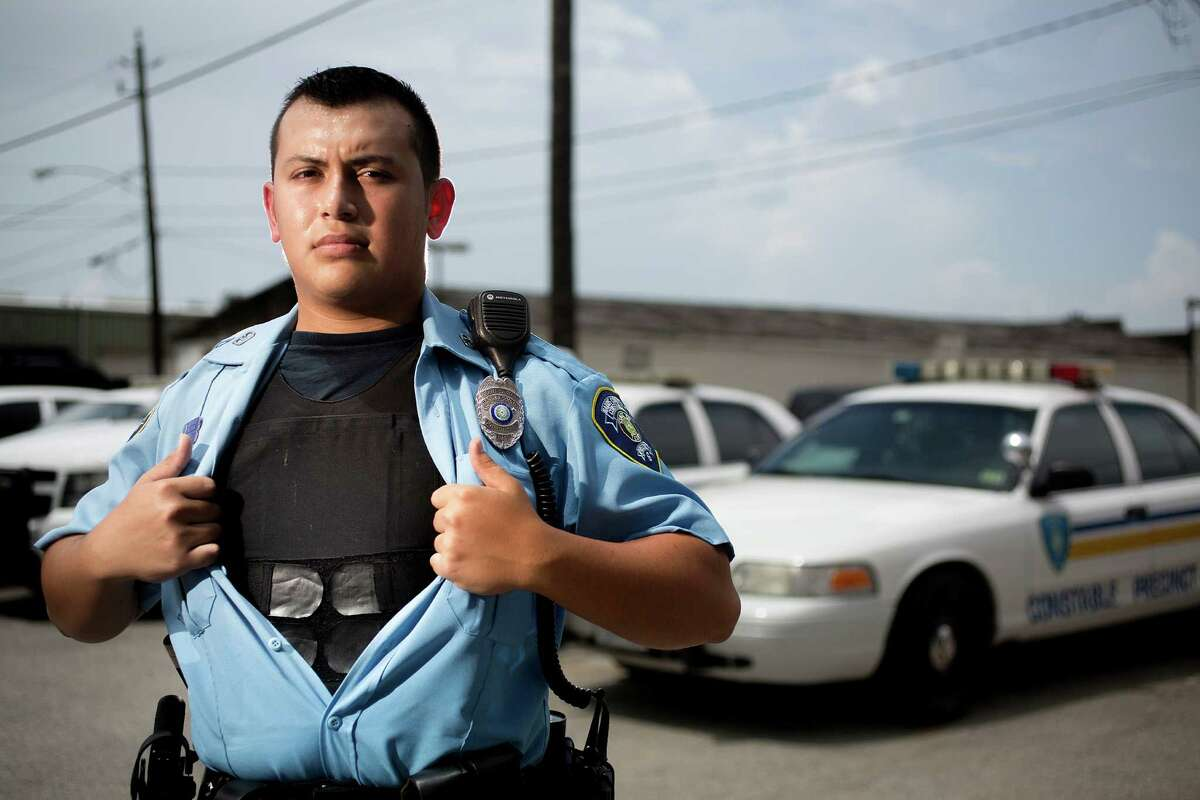 A Harris County Constable Precinct 6 officer shows his bulletproof vest before going on patrol Monday.