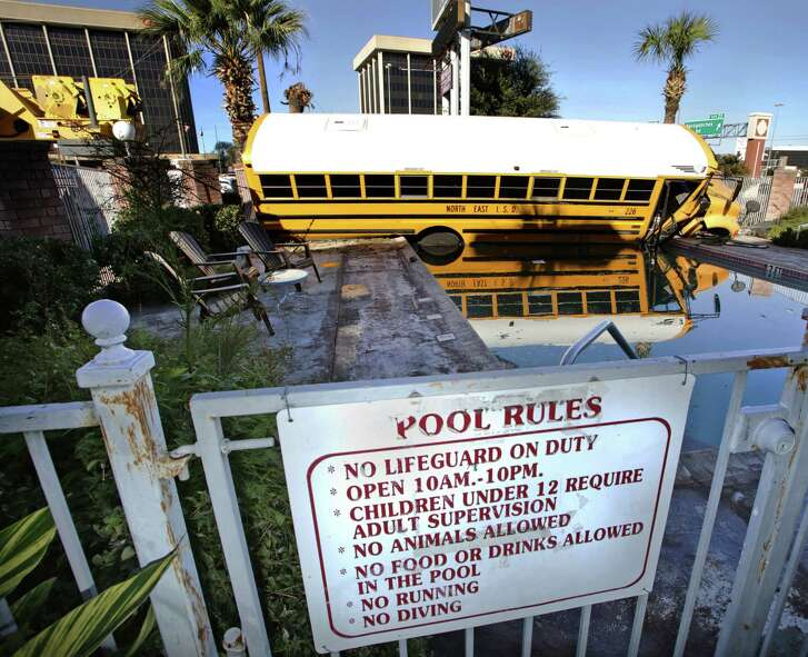 A North East ISD school bus came to rest in the pool at Town House Motel on 410 between Broadway and Nacogdoches, after the driver lost control, severed a utility pole and smashed through a fence.  There were no students on the bus.  The driver had minor injuries.  Jan. 17, 2013.