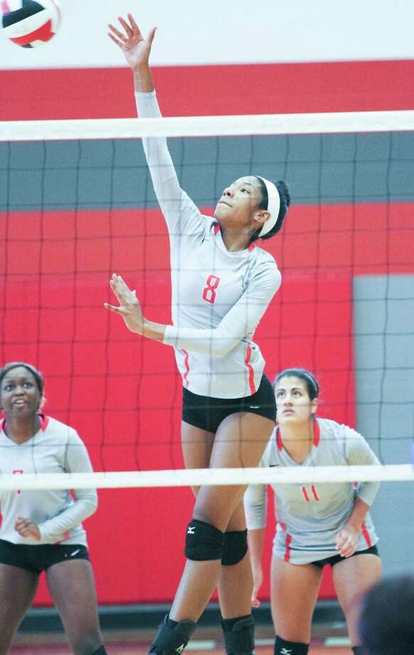 Judson's Jordan Vail (8) scores a kill during the Rockets' 2-1 match victory over the Jay Lady Mustangs Saturday to take first place in the Wagner Volleyball Invitational. Photo: Greg Bell / For The Northeast Herald