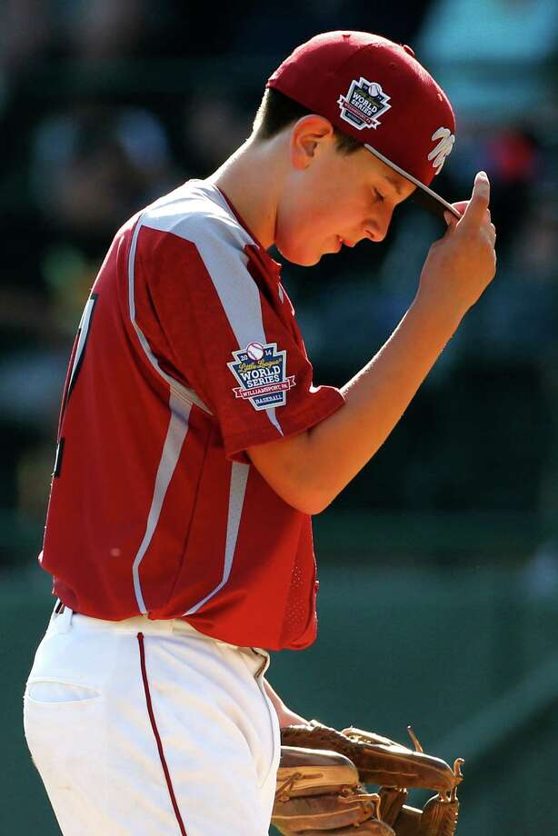 Lynnwood pitcher Tyler Durbin stands on the mound after allowing two runs to score on wild pitches during the sixth inning of an elimination baseball game against Pearland at the Little League World Series tournament in South Williamsport, Pa., Monday, Aug. 18, 2014. Pearland won 11-4. (AP Photo/Gene J. Puskar) Photo: Gene J. Puskar, Associated Press / AP