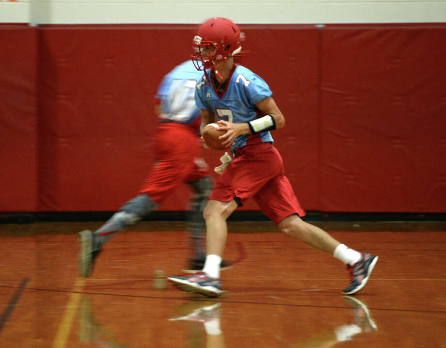 Lumberton's Stephen Yarbro, No. 7, runs through drills during practice Monday. The team was forced to practice inside due to lightening and stormy weather. The Lumberton Raiders football team practice Monday afternoon.  Photo taken Monday 8/18/14  Jake Daniels/@JakeD_in_SETX Photo: Jake Daniels / ©2014 The Beaumont Enterprise/Jake Daniels