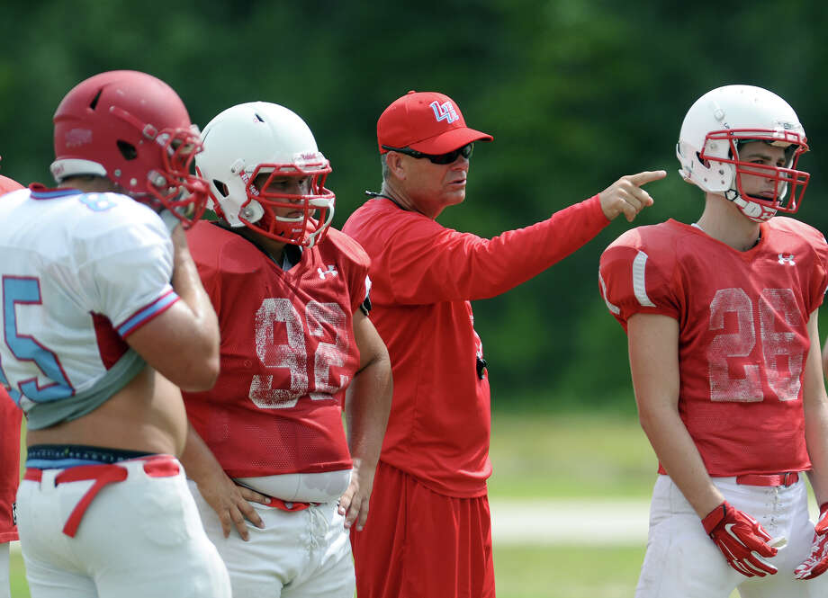 Coach Larry Haynes directs players during practice Monday. The Lumberton Raiders football team practice Monday afternoon.  Photo taken Monday 8/18/14  Jake Daniels/@JakeD_in_SETX Photo: Jake Daniels / ©2014 The Beaumont Enterprise/Jake Daniels