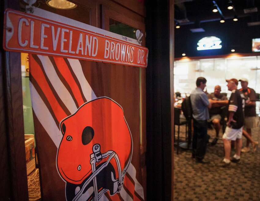 Alamo Area Browns Backers members gather to watch the Cleveland Browns play the Washington Redskins, Monday, Aug. 18, 2014, at Fox & Hound Sports Tavern in San Antonio. (Darren Abate/For the Express-News)
