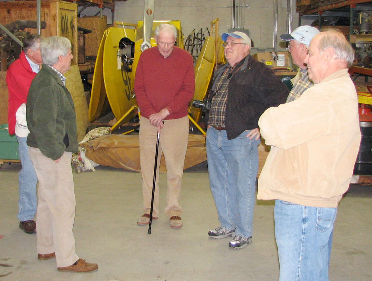 John K. Desmond Jr., center, speaks to members of Experimental Aircraft Association (EAA) Chapter 78 (Delaware Valley) in April 2011. (Courtesy Tom Russell)