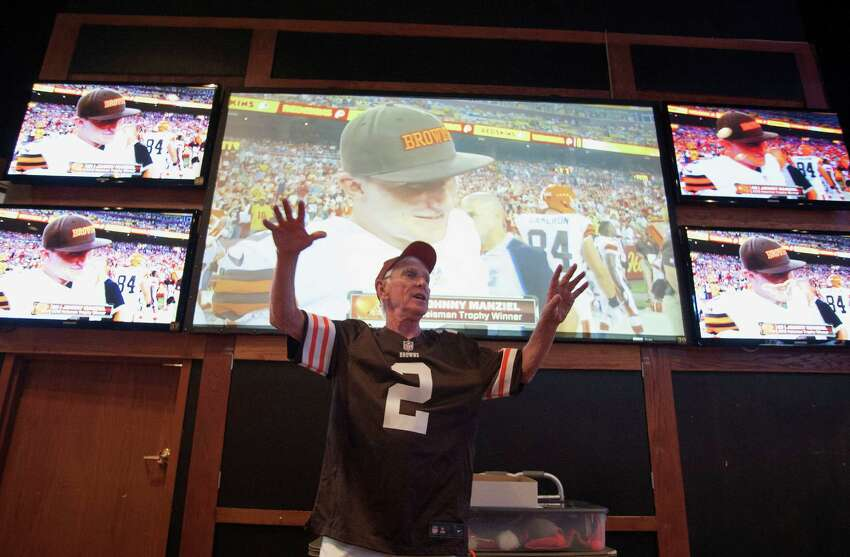 Alamo Area Browns Backers president Larry Jackson welcomes members who gathered to watch the Cleveland Browns play the Washington Redskins, Monday, Aug. 18, 2014, at Fox & Hound Sports Tavern in San Antonio. (Darren Abate/For the Express-News)