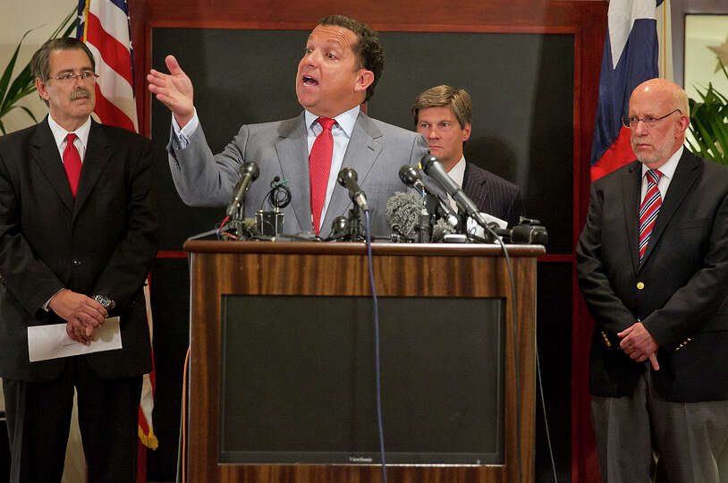 From left, David Botsford, Tony Buzbee, Bobby Birchfield and Ben Ginsberg address reporters during a