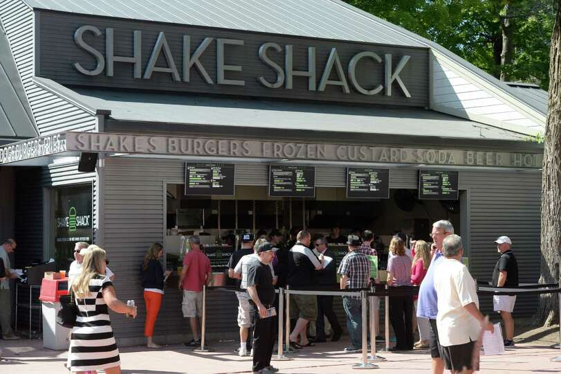 Race patrons line up for their food at the Shake Shack Monday afternoon, Aug. 18, 2014, at Saratoga