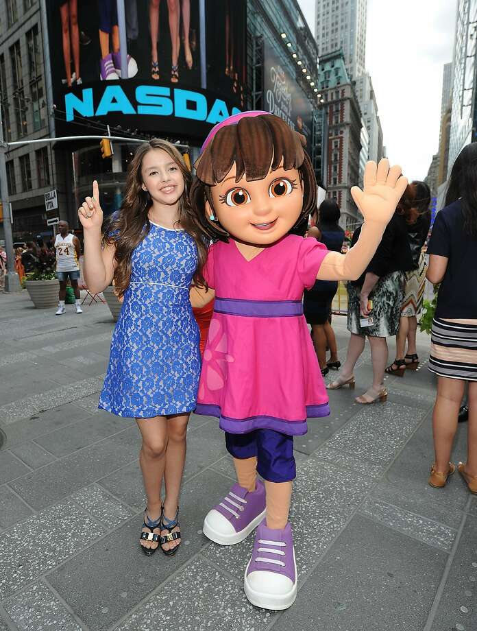Fatima Ptacek (left) and Dora pose for a photo at the NASDAQ Stock Market closing bell in New York's Times Square. Photo: Brad Barket, Getty Images For Nickelodeon