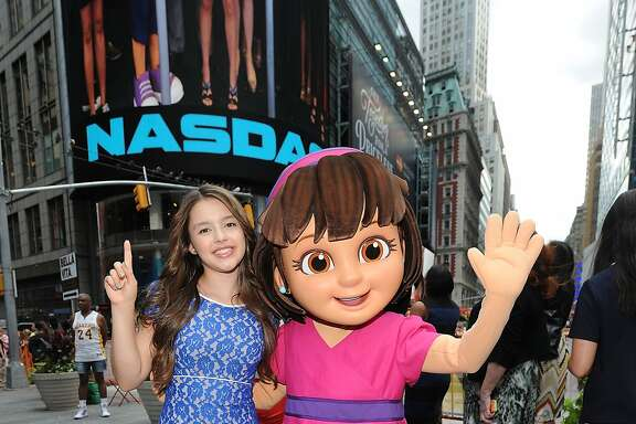 NEW YORK, NY - JULY 29:  (L-R) Fatima Ptacek(L) and Dora pose for a photo at the NASDAQ Stock Market Closing Bell in Times Square at NASDAQ on July 29, 2014 in New York City.  (Photo by Brad Barket/Getty Images for Nickelodeon)