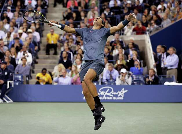 FILE - In this Sept. 9, 2013, file photo, Rafael Nadal, of Spain, reacts after defeating Novak Djokovic, of Serbia, during the men's singles final of the 2013 U.S. Open tennis tournament. Nadal will not defend his title at the U.S. Open because of an injured right wrist. Nadal and the tournament announced his withdrawal Monday, Aug. 18, 2014, a week before the year's last Grand Slam tournament begins. (AP Photo/Peter Morgan, File) ORG XMIT: NY153 Photo: Peter Morgan / AP