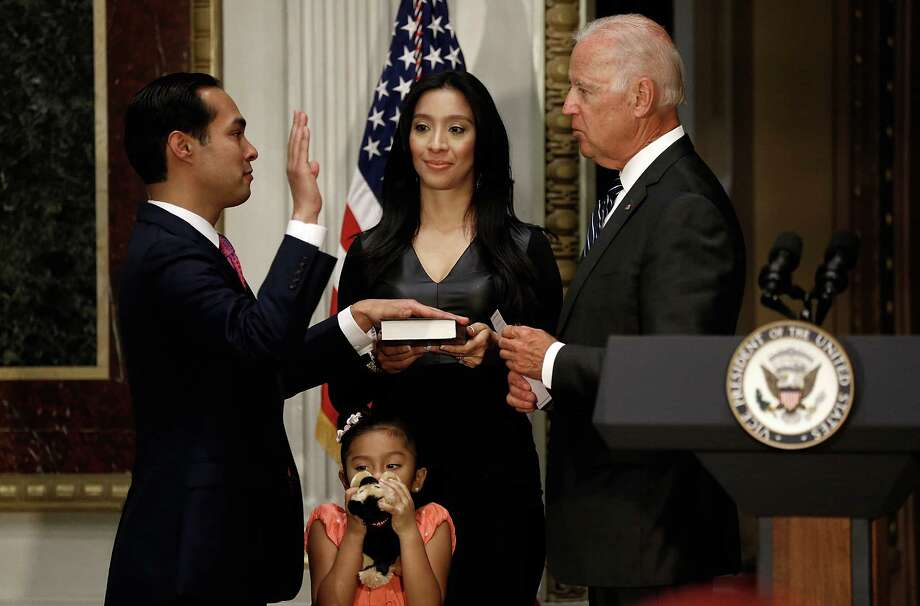 U.S. Vice President Joe Biden swears in Secretary of Housing and Urban Development Julian Castro on Monday as his wife and daughter look on.  Photo: Win McNamee, Staff / 2014 Getty Images