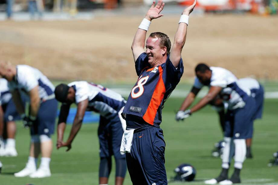 In advance of Saturday night's preseason game at Denver, the Texans will practice three times with QB Peyton Manning and the Broncos this week. Photo: Ed Andrieski, STF / AP