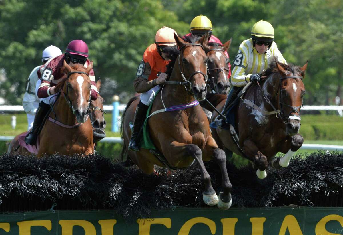 #5 Syros with jockey Jack Doyle, center, goes wire to wire in the steeplechase event Monday afternoon, Aug. 18, 2014, on the main track at Saratoga Race Course in Saratoga Springs, N.Y. (Skip Dickstein/Times Union)