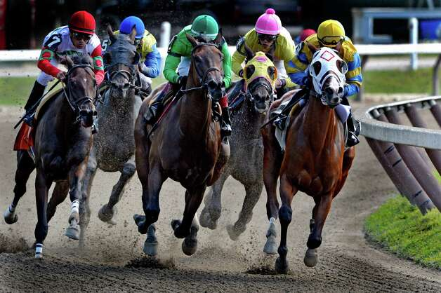 #1 Bobby Jo, tucked in the second row, second from right, enters the top of the stretch on the way to a win in the fourth race Monday afternoon, Aug. 18, 2014, on the main track at the Saratoga Race Course in Saratoga Springs, N.Y.  (Skip Dickstein/Times Union) Photo: SKIP DICKSTEIN