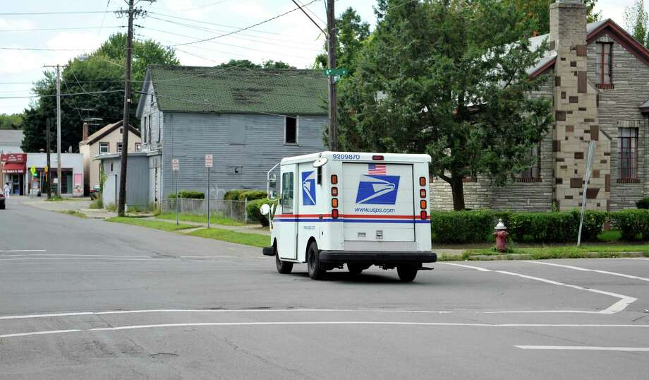A US Postal vehicle drives west on 102nd St. crossing over 6th Ave., near the area of a recent shooting on Monday, Aug. 18, 2014, in Troy, N.Y.   (Paul Buckowski / Times Union) Photo: Paul Buckowski / 00028221A