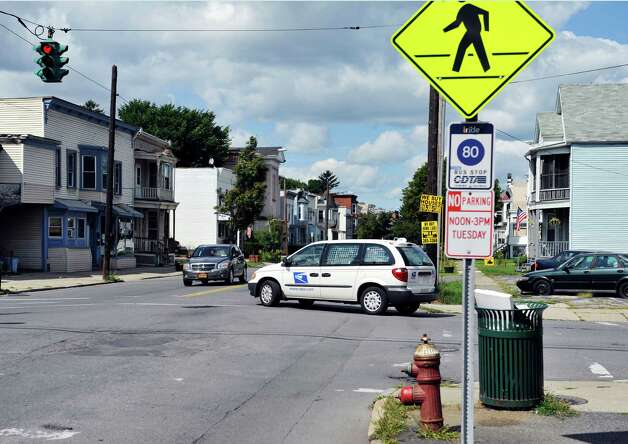 A US Postal vehicle turns onto 5th Ave. from 102nd St., near the area of a recent shooting, on Monday, Aug. 18, 2014, in Troy, N.Y.   (Paul Buckowski / Times Union) Photo: Paul Buckowski / 00028221A