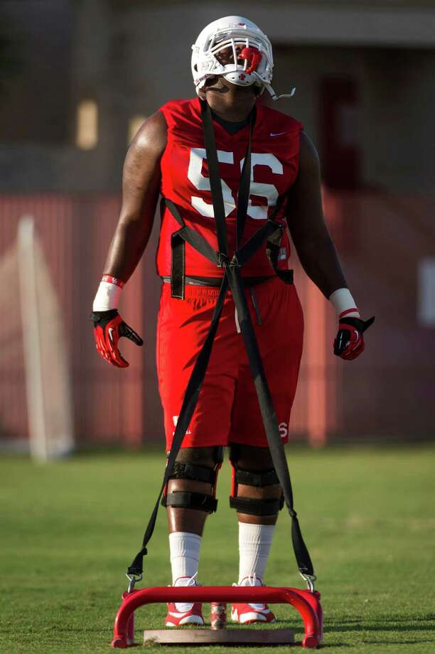 The Houston Cougars will rely on Damien Parris to do the job at left tackle this season. Photo: Smiley N. Pool, Staff / © 2013  Houston Chronicle
