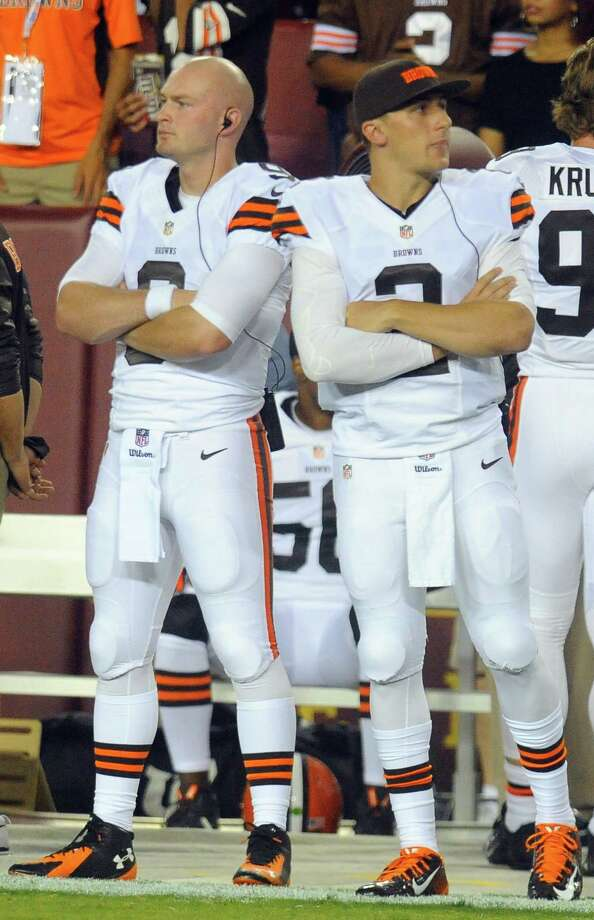 Cleveland Browns quarterbacks Connor Shaw, left, and Johnny Manziel (2) wait for their time on the field during the first half of an NFL preseason football game against the Washington Redskins Monday, Aug. 18, 2014, in Landover, Md. (AP Photo/Richard Lipski) Photo: Richard Lipski, Associated Press / FR170623 AP