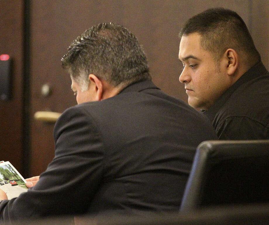 Under Texas' law of parties, Simon Rene Garcia (right), 30, was convicted of murder. Photo: John Davenport / Express-News / ©San Antonio Express-News/John Davenport
