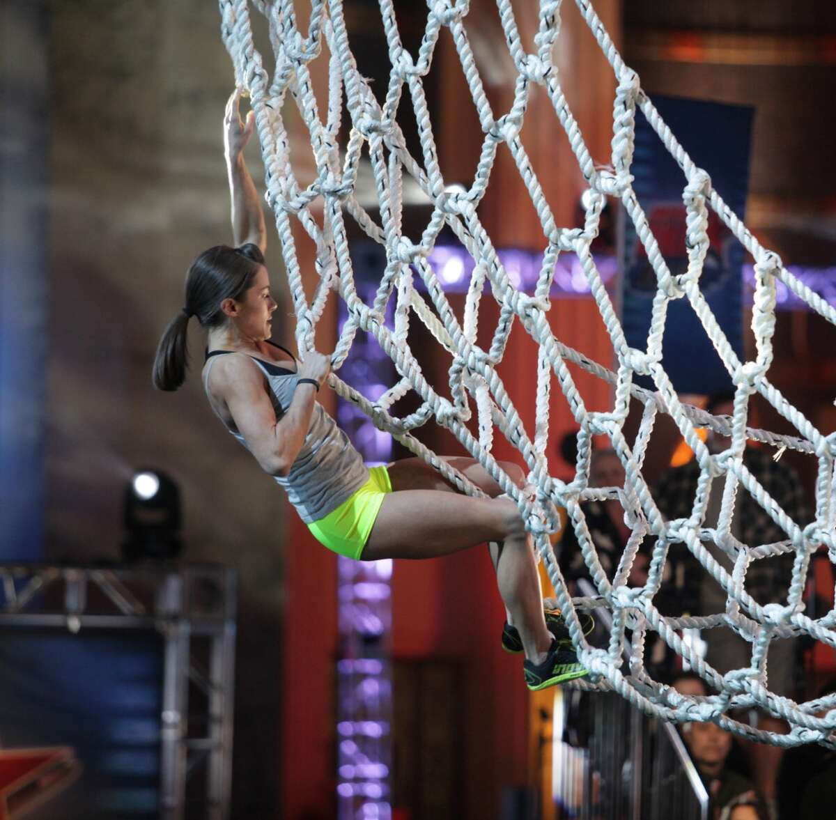 In this undated publicity photo provided by NBC, Kacy Catanzaro competes in an episode of