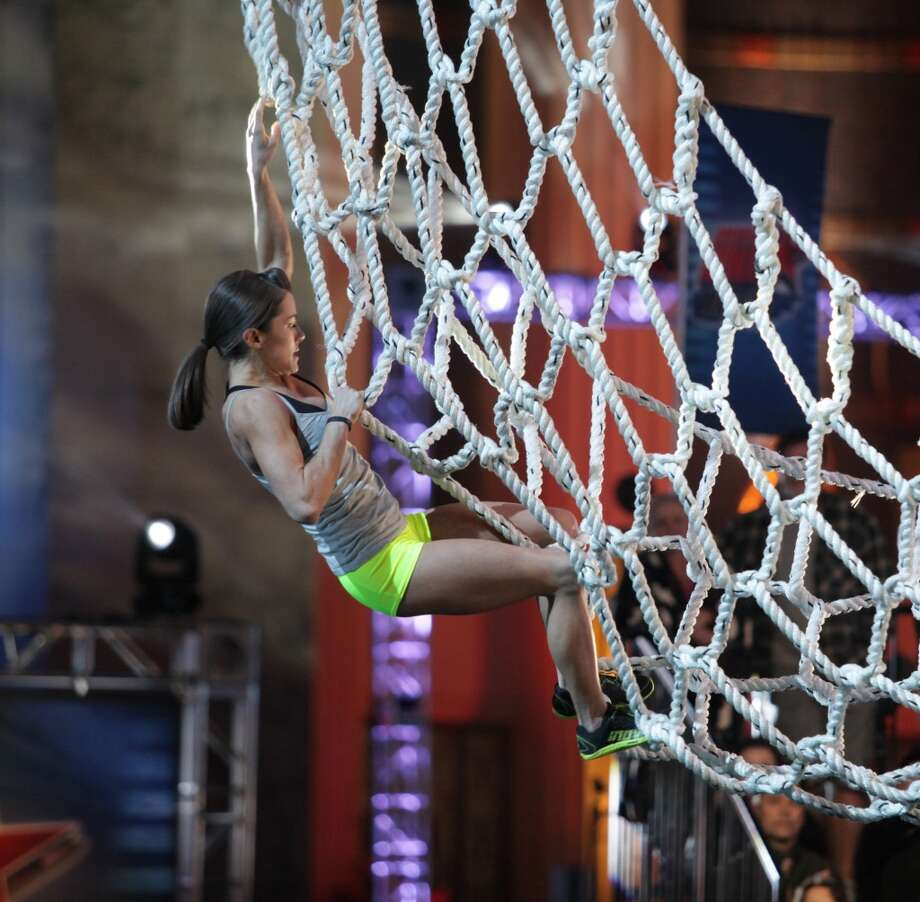"In this undated  publicity photo provided by NBC, Kacy Catanzaro competes in an episode of ""American Ninja Warrior."" Photo: Peter Larsen, Associated Press"