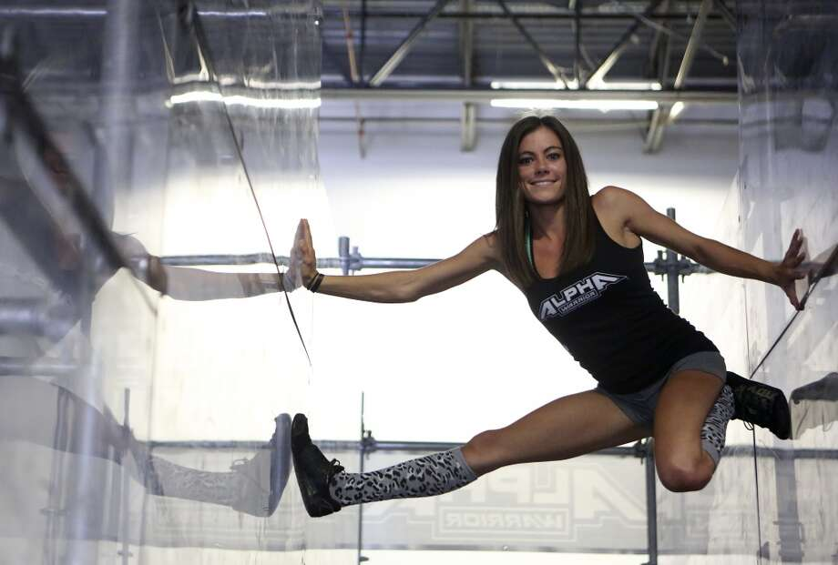 "Kacy Catanzaro, the 5-feet-tall woman who made history on ""American Ninja Warrior"" and who went viral a couple of years ago, lives and trains in San Antonio with her boyfriend and fellow Ninja, Brent Steffensen. Photo: Helen L. Montoya, San Antonio Express-News"