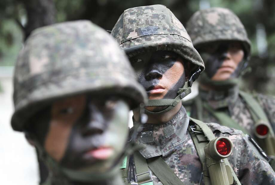 South Korean army soldiers take part in an anti-terror exercise as part of Ulchi Freedom Guardian in Seoul, South Korea, Monday, Aug. 18, 2014. The U.S.-South Korean military exercises starting Monday and involving tens of thousands of troops are described by the allies as routine and defensive, but Pyongyang sees them as invasion preparation. (AP Photo/Ahn Young-joon) Photo: Ahn Young-joon, Associated Press