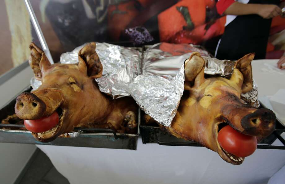 "In this Aug. 17, 2014 photo, slow-roasted pork known as ""Hornado,"" a traditional dish consisting of marinated, slow-roasted pork, is presented before the judges of the national contest to choose the country's best ""Hornado,"" in Riobamba, Ecuador. After years of disputes within the different regions of Ecuador, over who could make the best ""Hornado,"" the championship on Sunday finally settled the issue. (AP Photo/Dolores Ochoa) Photo: Dolores Ochoa, Associated Press"