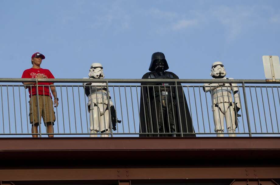"PHILADELPHIA, PA - AUGUST 18:  Individuals dressed as ""Star Wars"" characters Darth Vader and Stormtroopers stand for the national anthem prior to the game against the Seattle Mariners and Philadelphia Phillies on August 18, 2014 at Citizens Bank Park in Philadelphia, Pennsylvania. (Photo by Mitchell Leff/Getty Images) Photo: Mitchell Leff, Getty Images"