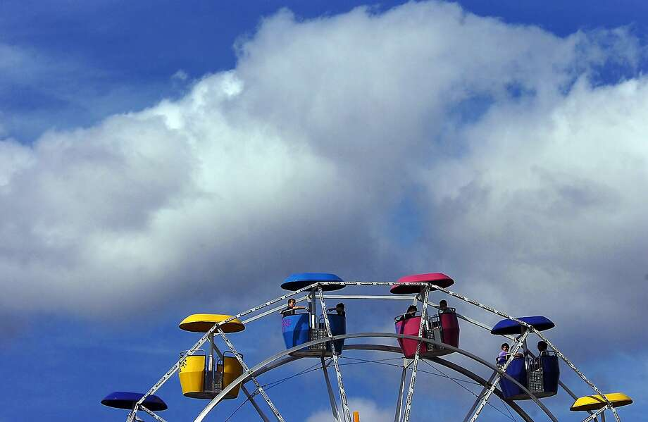 Fairgoers ride the Expo Wheel on Monday, Aug. 18, 2014, during the 157th annual Harford Fair in Harford, Pa.  (AP Photo / The Scranton Times-Tribune, Butch Comegys) Photo: Butch Comegys, Associated Press