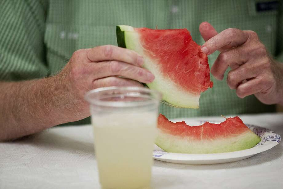 Alabama Gov. Robert Bentley picks seeds out of a piece of watermelon during a Watermelon Social at the Governor's Mansion on Monday, Aug. 18, 2014, in Montgomery, Ala. Gov. Bentley grew over 75 watermelons in his garden this year.(AP Photo/Brynn Anderson) Photo: Brynn Anderson, Associated Press
