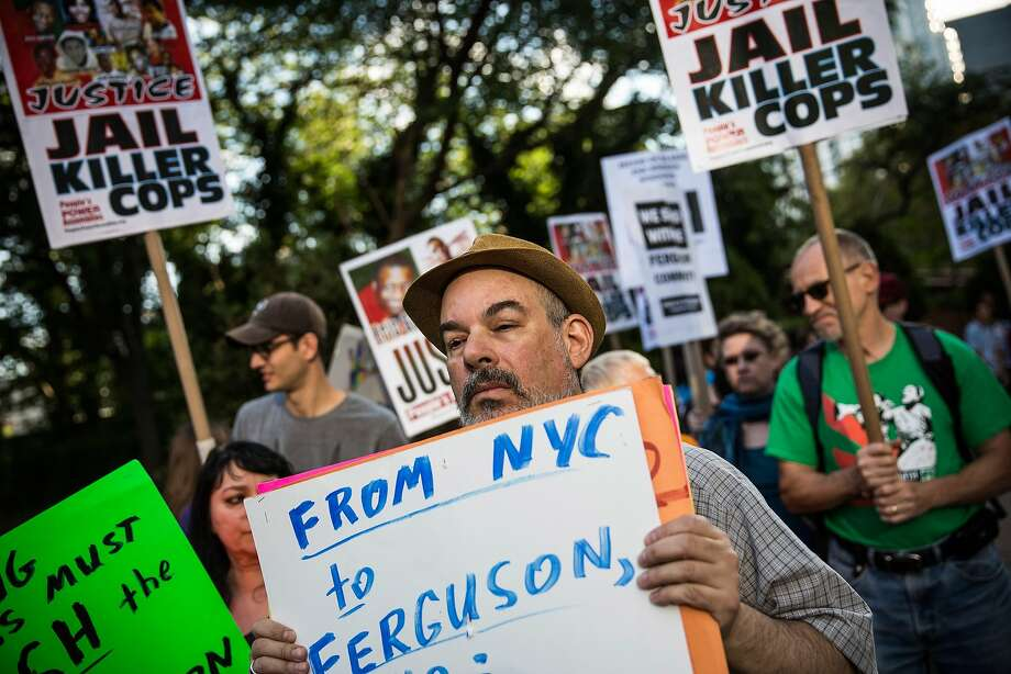 "NEW YORK, NY - AUGUST 18:  Protesters hold a rally in solidarity with the people of Ferguson, Missouri protesting the death of Michael Brown, and the excessive use of force by police on August 18, 2014 in New York City. Protesters marched in a circle, held up signs and chanted rally cries including, ""Hands up, don't shoot!""  (Photo by Andrew Burton/Getty Images) Photo: Andrew Burton, Getty Images"