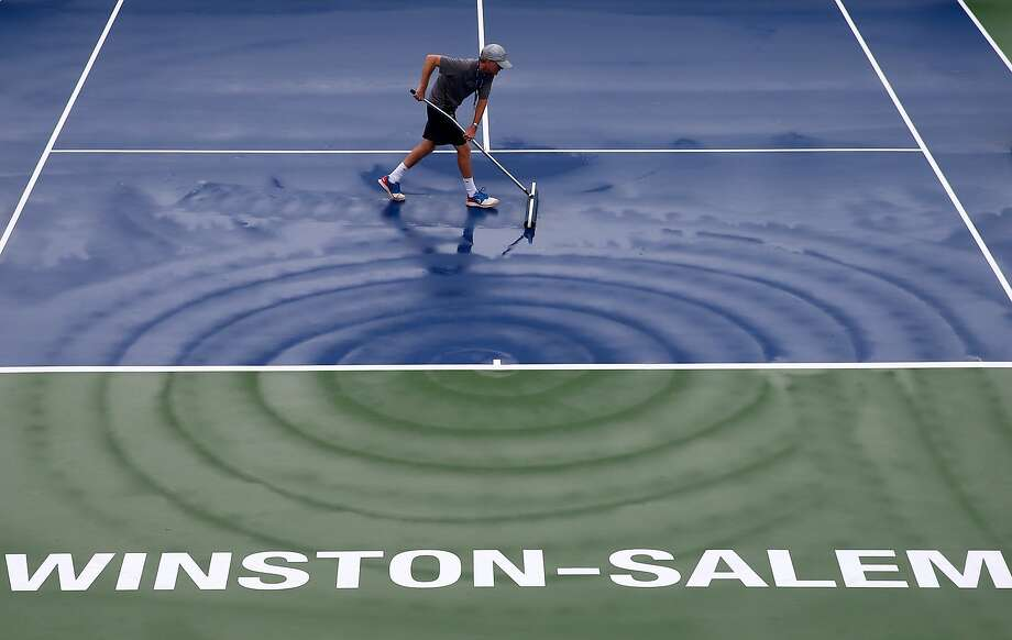 WINSTON SALEM, NC - AUGUST 18:  A man works to dry the court during the Winston-Salem Open at Wake Forest University on August 18, 2014 in Winston Salem, North Carolina.  (Photo by Streeter Lecka/Getty Images) *** BESTPIX *** Photo: Streeter Lecka, Getty Images