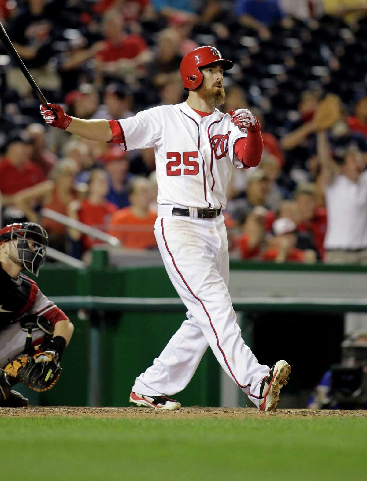 Washington Nationals?' Adam LaRoche follows through on a game-winning solo home run during the 11th inning of a baseball game against the Arizona Diamondbacks, Monday, Aug. 18, 2014, in Washington. The Nationals won 5-4 in 11 innings. (AP Photo/Luis M. Alvarez) ORG XMIT: NAT105