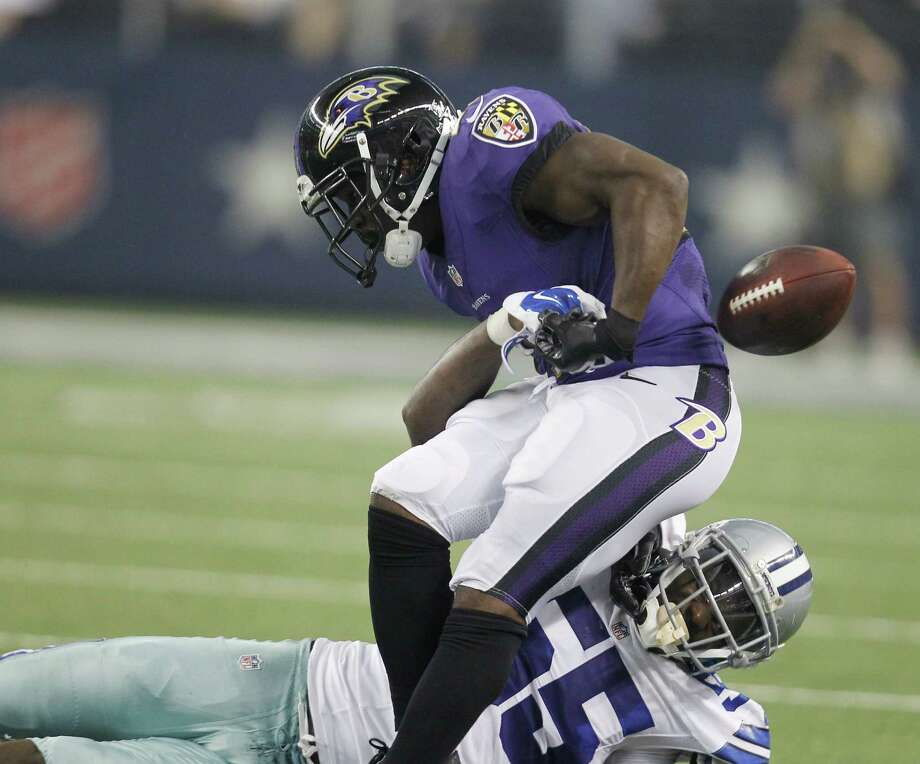 Rolando McClain (bottom) and the defense played better against the Ravens, but the Cowboys dropped to 0-2 in the preseason. Photo: Matt Strasen / Associated Press / FR170476 AP
