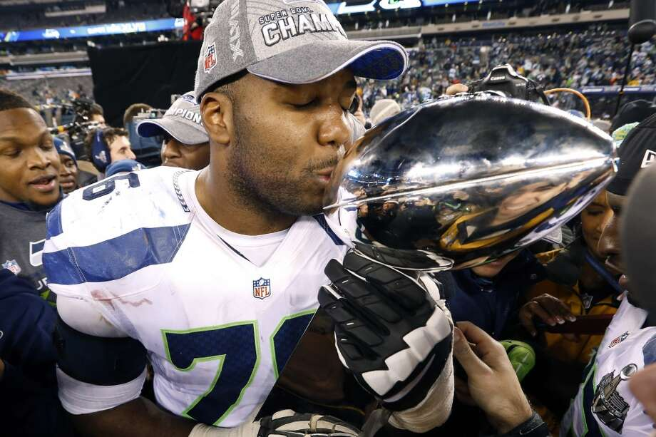 Seahawks tackle Russell Okung kisses the Lombardi Trophy after Super Bowl XLVIII on Feb. 2, 2014, in East Rutherford, N.J. The Seahawks won 43-8. Photo: Paul Sancya, Associated Press